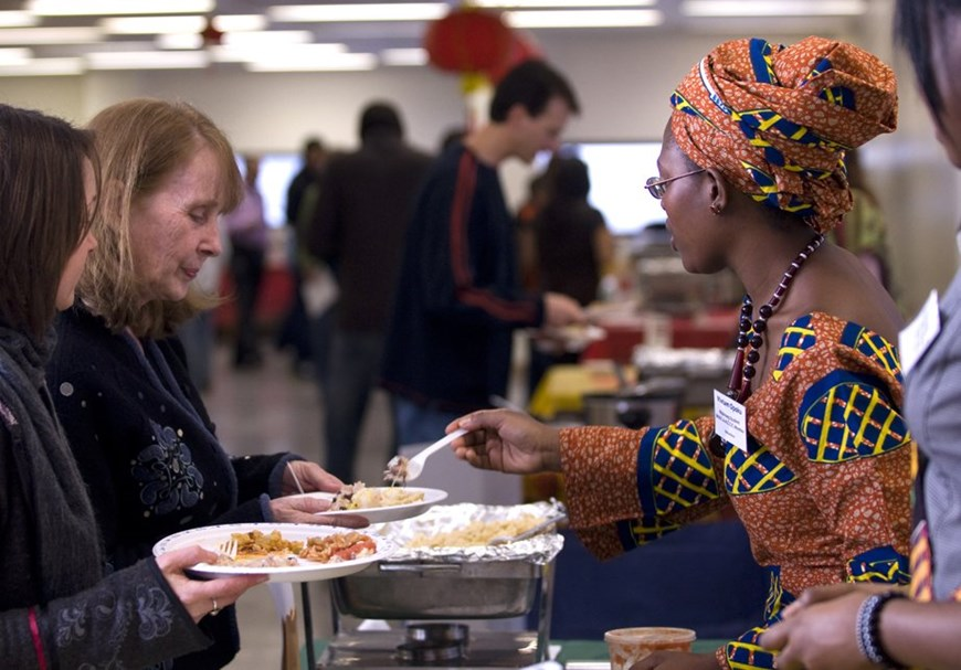 People being served food at the International Food Fest