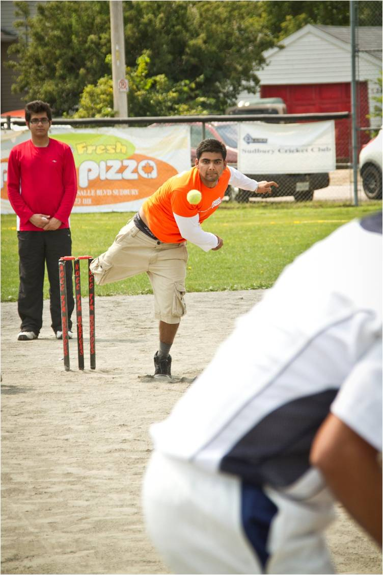 Cricketer bowling
