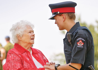North Bay Police officer assisting a senior woman.
